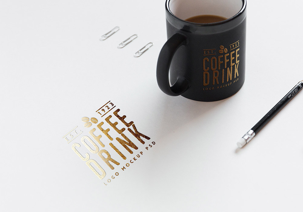 Free Logo Mockup on Paper And Coffee Cup