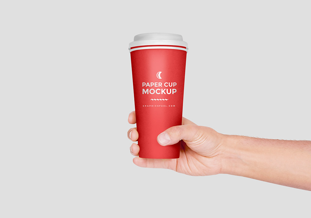 Paper Cup In Hand Mockup PSD