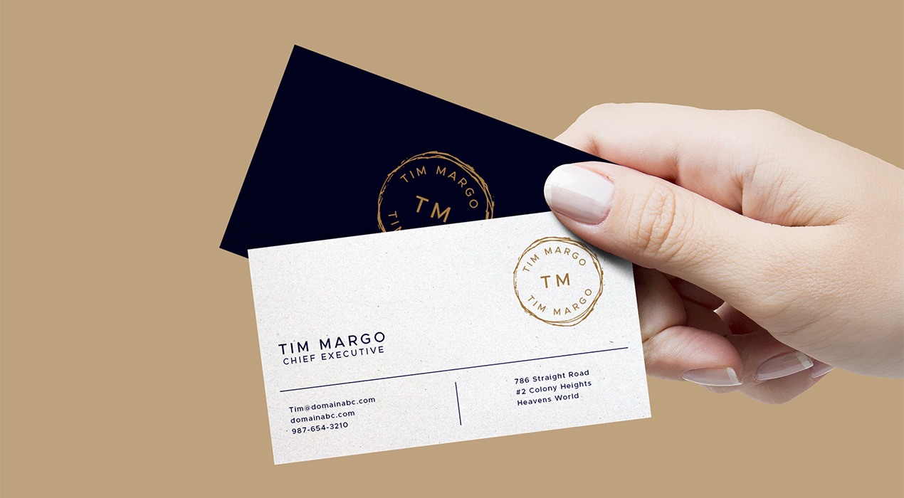 Hand Holding Business Cards Mockup - GraphicsFuel