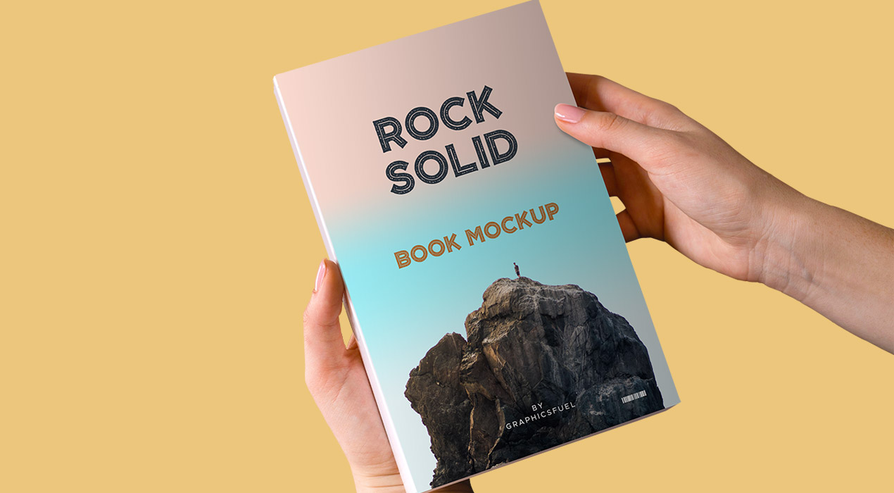 Paperback Book In Hand Mockup PSD